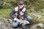 fisherman with steelhead trout photo